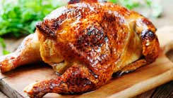 whole-chicken-on-cutting-board-c