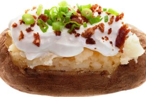 baked potatoes with kosher bac'n pieces from The Jewish Kitchen