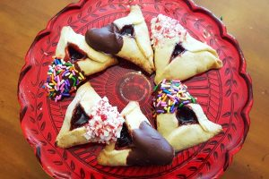 chocolate dipped candy hamantaschen from The Jewish Kitchen