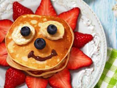 happy face pancakes with berries